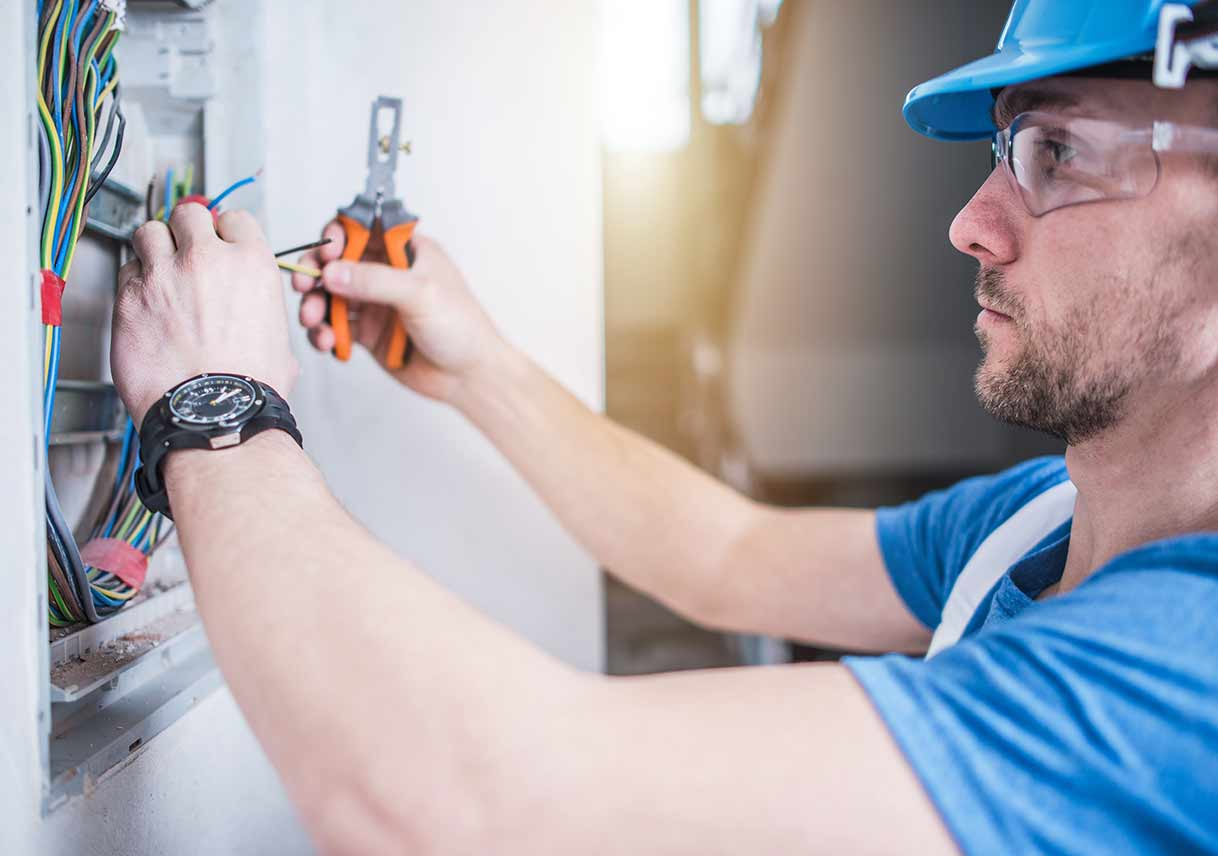 electrician adjusting electrical panel in home
