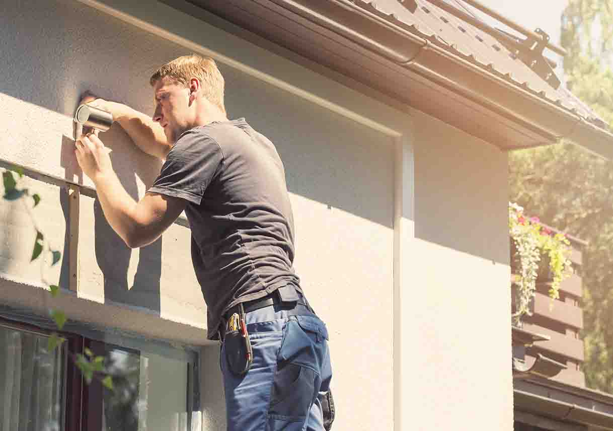 professional electrician installing outdoor light