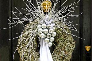 Christmas wreath with silver pendants on door