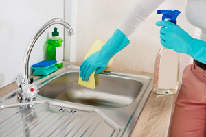 Woman cleaning the kitchen sink