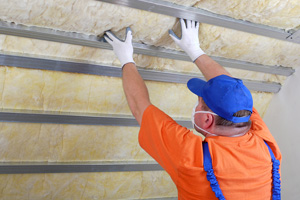 contractor installing wool attic insulation
