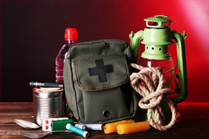 emergency kit with supplies for light, food, and first aid