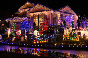 house at night lavishly decorated with Christmas lights and figurines