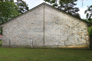 house with cracked foundation and exterior wall