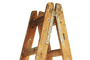 isolated wooden ladder standing up