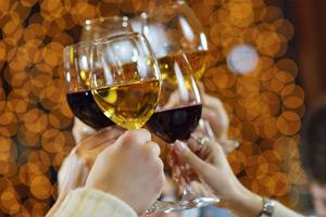 several wine glasses toasting