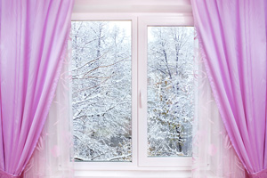 window with pink curtains and winter view outside
